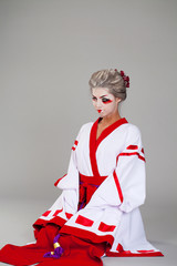 Beautiful young woman in white kimono