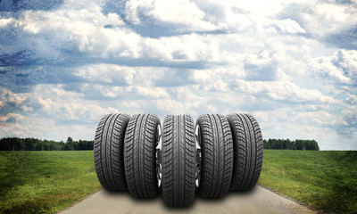 Wedge of new car wheels on road stretches into the distance