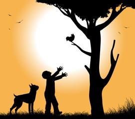 cane con il suo cane sotto un albero