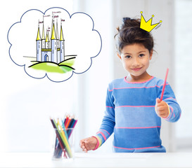 happy little girl showing pencil or crayon