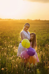 happy family with balloons outdoor