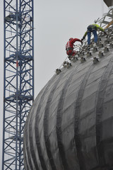 Worker using safety strap on the roof of a bulding under constru