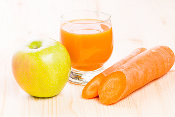 Fresh vitamin juice on wooden table. Healthy fruit background