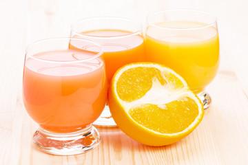 Fresh juice with cut in half orange fruit
