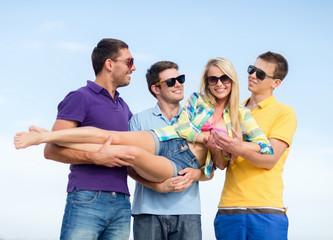group of friends having fun on beach