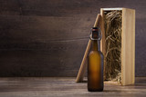 Fototapety Craft beer bottle with a wooden gift box on a rustic table
