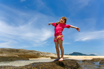 Happy child playing in sea. Summer vacations concept