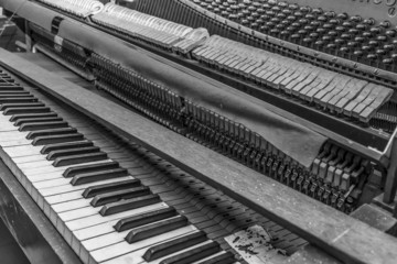 Old abandoned piano, black and white