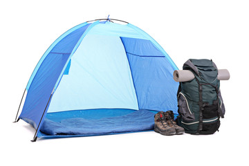 Blue tent, green rucksack and a pair of boots