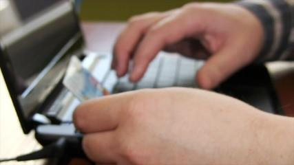 Businessman using credit card for online payment