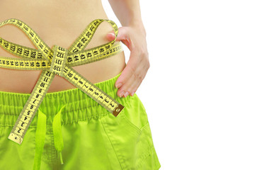 Woman's fit belly with measuring tape