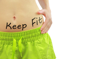 Woman's fit belly with Keep Fit text, isolated on white