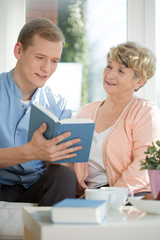 Male caregiver assisting senior woman