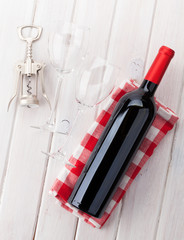 Red wine bottle, glasses and corkscrew