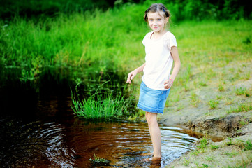 Preety kid girl near river