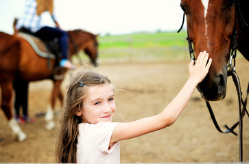 Horse and lovely girl - best friends