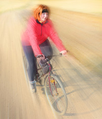 Overweight woman slimming on bicycle.