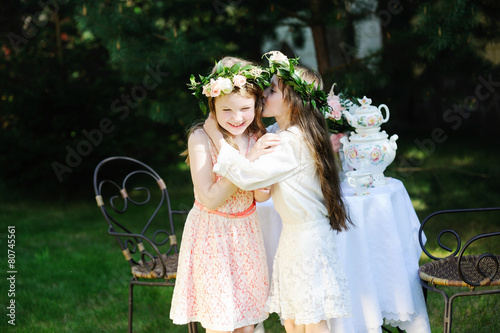 Two adorable kid girls with flower wrearth - 80745561