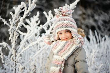 Adorable little girl in winter park