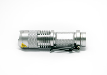 silver flashlight on white background