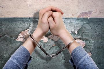 Handcuffs on the Hands closeup