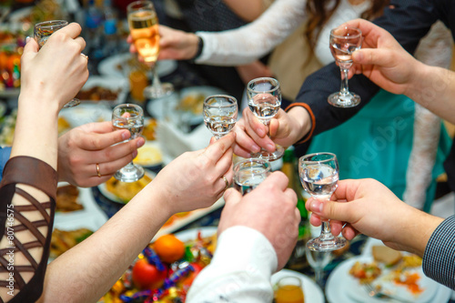 People hands Clinking glasses with vodka and wine - 80746575
