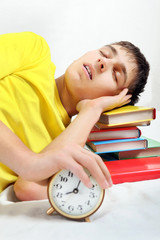 Tired Student sleep with Alarm Clock