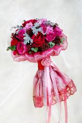 Purple wedding bouquet on a brilliant fabric