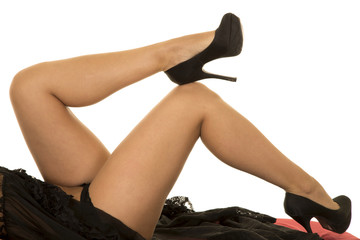 woman in black lingerie legs one heel on knee