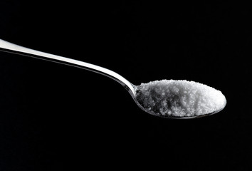 Teaspoon full of white sugar