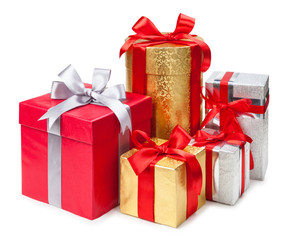 Gold, silver and red gift boxes on white background