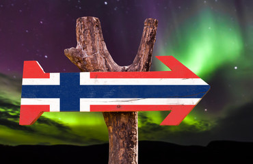 Norway Flag wooden sign with northern lights background
