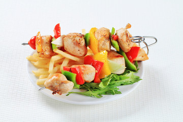 Chicken Shish kebabs with fries