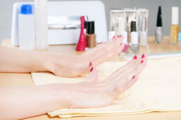 Woman client having manicure
