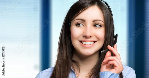 Leinwanddruck Bild Smiling call center operator