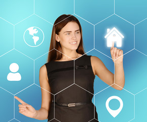 Business woman presses home icon located in hexagon