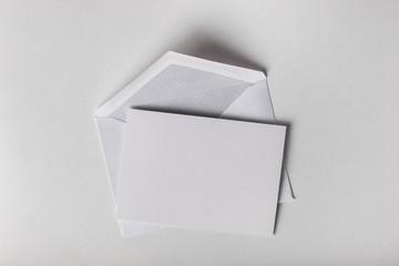 Envelope. Blank card and envelope over grey background