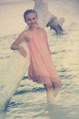 Summer vacation, portrait of  young girl on the beach