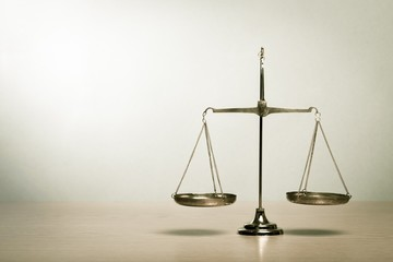 Justice. Law scales on table. Symbol of justice
