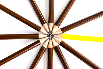 brown wooden pencil arrange as circular with one of different pe