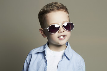 Smiling Funny child.fashionable little boy in sunglasses