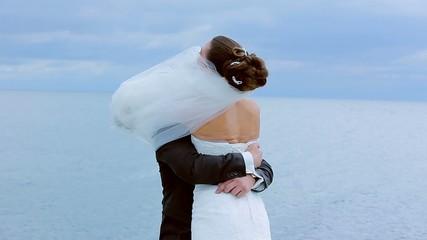 Groom gently whirl the bride.