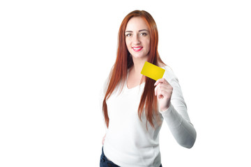 Young smiling redhead woman holding gold credit card