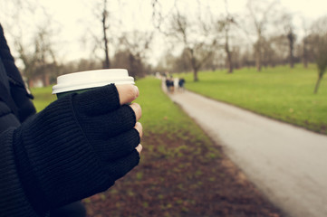 man with a hot drink in a paper cup in Hyde Park in London, Unit