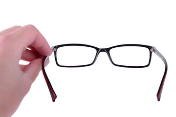 Reading eyeglasses in hand