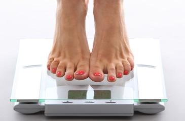 woman feet on a bathroom scale