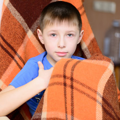 boy with a blanket
