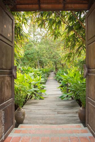 entrance gate to tropical garden - 80755903