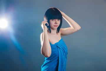 European-looking girl of about twenty brunette shook in blue tow
