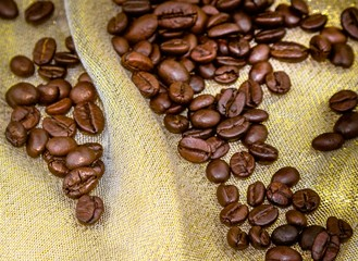 top of view of coffee beans on golden texture